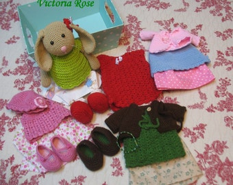 4 sets of clothes and one apple green vest and hat with a most lovely bunny who's name is Victoria Rose
