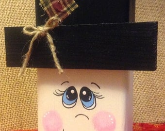 Wood snowman, shelf sitter, shelf, dresser, entry area.  Cute whimsical snowman with fabric scrap and twine bow on his hat.