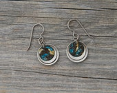 MIDDLE EARTH. Layered silver toned and patina brass circle earrings.