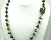 Leaf and Pearl Necklace in Antique Brass