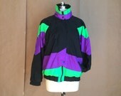 vintage 1990's vintage 90's windbreaker / oversized jacket / track suit / zip up jacket / neon colors / 90's club wear  / color block
