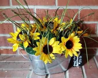 Sunflower and grass arrangement in oval tin bucket