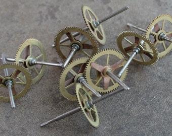 Vintage clock brass gears -- set of 9 -- D14