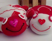 Pair of Sock Turtles Made from Red and White Heart Socks Adorned With Button Eyes and a Hand Stitched Mouth and Disc Inserted to keep flat