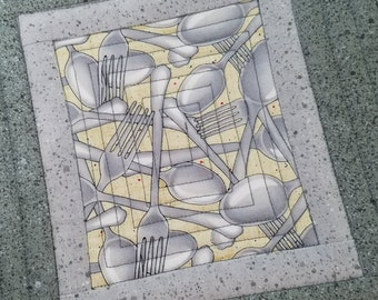 QUILTED MODERN MINIMALIST MugRugs SnackMats in a Set of 2. Yellow on Gray Granite Print cotton fabric.  A Quiltsy Handomade on Etsy item