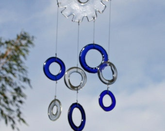 glass wind chime mobile made from clear and blue recycled wine and liquor bottles suspended from glass cog wheel