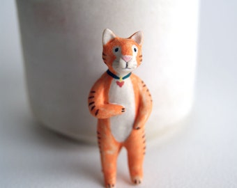 hand-painted porcelain cat pin - orange tabby cat