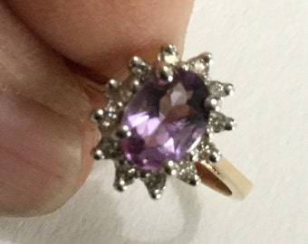 Amethyst and diamond ring set in 14K yellow gold.  VJSE