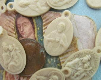 Twelve Vintage Celluloid Religious Medals