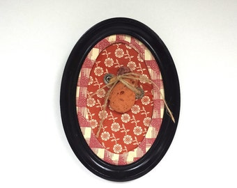 Rock Portrait In Vintage Oval Black Frame: with brick red gingham and floral print on vintage decorative papers {2014}