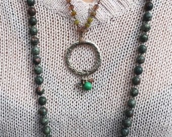 Ring With Bobbles on Knotted Silk Necklace