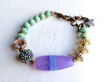 Crocus  - handmade bracelet, house bracelet, bead bracelet, purple turquoise bracelet, lavender jewellery, flower jewellery, songbead, uk