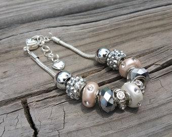 Pretty peach, white, and silver charm bracelet