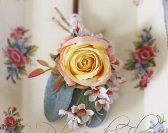 Chris - Men's Buttonhole / Boutonniere - vintage, country Garden style buttonhole, orange / peach rose, Geraldton wax and grey foliage.