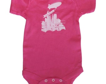 Baby One-Piece - The World Is Yours Cleveland (White on Hot Pink)