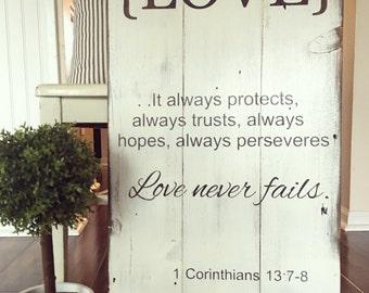 Corinthians 13. LOVE never fails. Painted barn wood sign