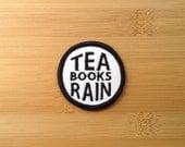 "Tea Books Rain Patch - Iron or Sew On - 2"" - Embroidered Circle Appliqué - Black White - Cozy Nerd Phrase - Hat Bag Accessory Handmade USA"