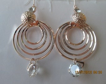 4 Hoop Gold Tone Hoop Earrings with Clear Crystal Beads and a Gold Tone Charm