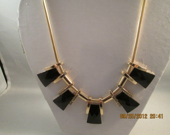 Pendant Necklace with Gold Tone, Black and Clear Rhinestone Pendants on a Gold Tone chain
