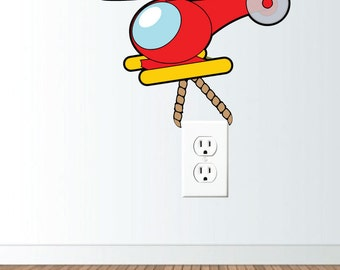 Toy Helicopter Flying and Hauling Wall Vinyl Decal to decorate Electrical Wall Plate or Light Switch, hs0295
