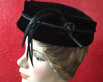 Black Velvet Vintage Pillbox Hat with Sleek Black Feather Detail