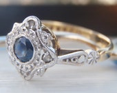 Vintage Sapphire and Diamond Art Deco Style Engagement Ring. Lovely Ornate Patterned Shoulders. Quality 18K White & Yellow Gold. Super Sweet
