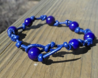 Navy blue leather Bracelet knotted with ceramic Navy Blue Beads and Bead Closure