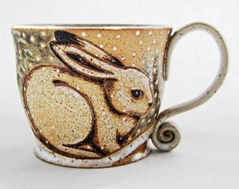 Winter Rabbit Mug, great gift idea, pottery mug, rabbit mug, winter scene mug, holds 14 oz and is dishwasher and microwave safe.