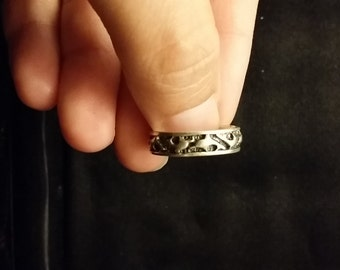 R 220 Sterling silver band with sharks or dolphins  approximate size 7