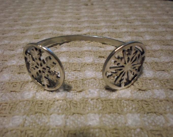 snowflake top open bracelet quarter size