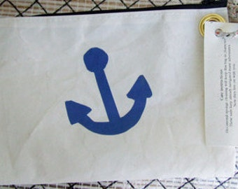 "Wristlet made from Recycled Sailcloth... 8""X 5"" With a grommet and leash. Graphics vary."