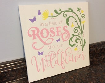 in a field of roses she is a wildflower wood sign wall decor toddler room flowers butterfly nursery