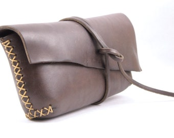 simple leather clutch in chocolate brown oiled vegetable tanned leather. hand sewn leather bag. underthetree.