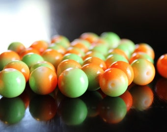 40 round green and orange, glass beads, baking painted round, 10 mm, 1.3 - 1.6 mm hole
