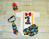 dinosaur first birthday outfit with party hat, dinosaur cake smash boys birthday, dinosaur bodysuit, tie, diaper cover, hat