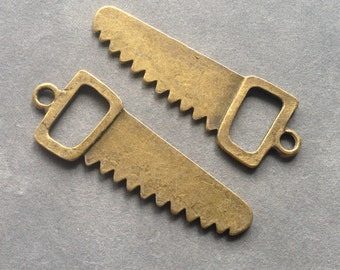 2 saw charms bronze tone , 57mm # CH 085