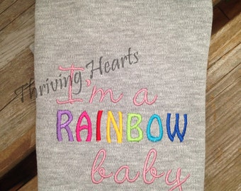 """Embroidered """"I'm a rainbow baby"""" onesie"""
