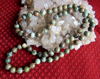 Necklace gemstone ryolite, olive green, browns, creams, 8mm rounds with 2mm 12k goldfilled beads and some hand knotting, , length 25 inch.