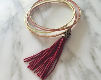 Multicolored bracelets with black tassel