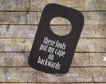 Funny FOOLS put my cape on BACKWARDS Baby Bib / Cool Gift / Present / Burp Cloth / Humour