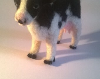 Needle felted cow sculpture