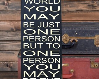 """To the World You May Be Just One Person But to One Person You May Be the World Vinyl Wooden Subway Art Sign 10"""" x 24""""  by HD Vinyl Designs."""