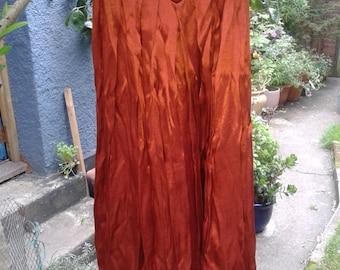 burnt orange paprika umber pleated full maxi skirt -  shiny metallic crinkle polyester - made in England - vintage UK 12 modern UK 8-10