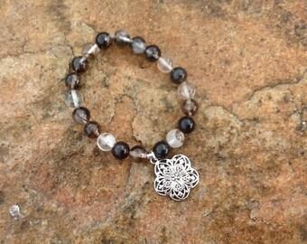 Black moss agate gemstone bracelet with antique pewter flower charm