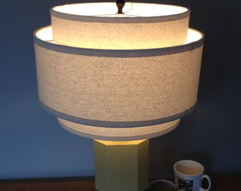 3 Tiered hardback lamp shade in off-white muslin fabric with edge trim, best for large table lamps. Free shipping to lower 48 states.