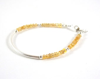 Bracelet 925 half-ring and faceted gemstones of Citrine. Birthstone of November