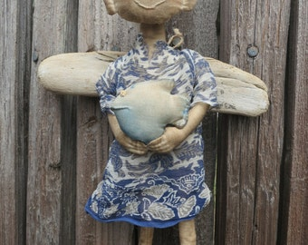 Cloth art doll Angel with а fish.
