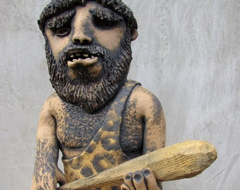Ceramic caveman with a hand carved wooden club