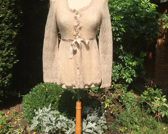 Beautiful 1970's oatmeal soft mohair cardigan with silk waist tie, mohair buttons and slightly puffed shoulders. Size s/m.