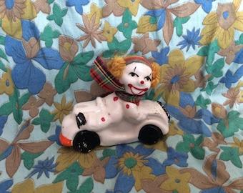 Vintage Retro Kitsch Scary Clown Ornament on a Motorbike / Car